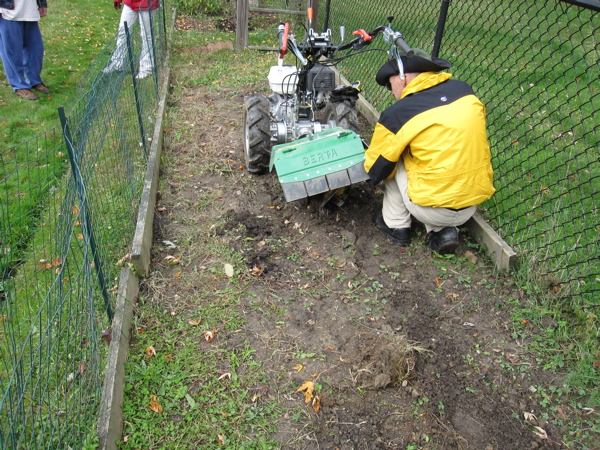Getting Bertha ready - we used the guide to prevent dirt from being thrown into their yard.