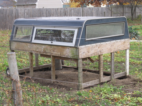 Repurposed truck cab serves as chicken coop